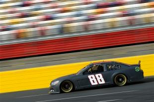 Dale Earnhardt Jr. drives the #88 National Guard Chevrolet during testing at Charlotte Motor Speedway on December 11, 2012 in Concord, North Carolina. (Jared C. Tilton/Getty Images)